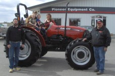 Dwight and Jamie Little are pictured with their family on their new Case IH Farmall 65A tractor.